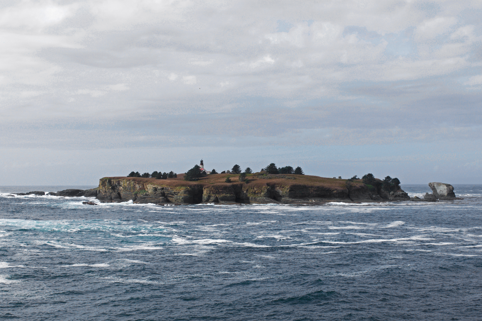 Tatoosh Island with a lighthouse as seen from the tip of Cape Flattery