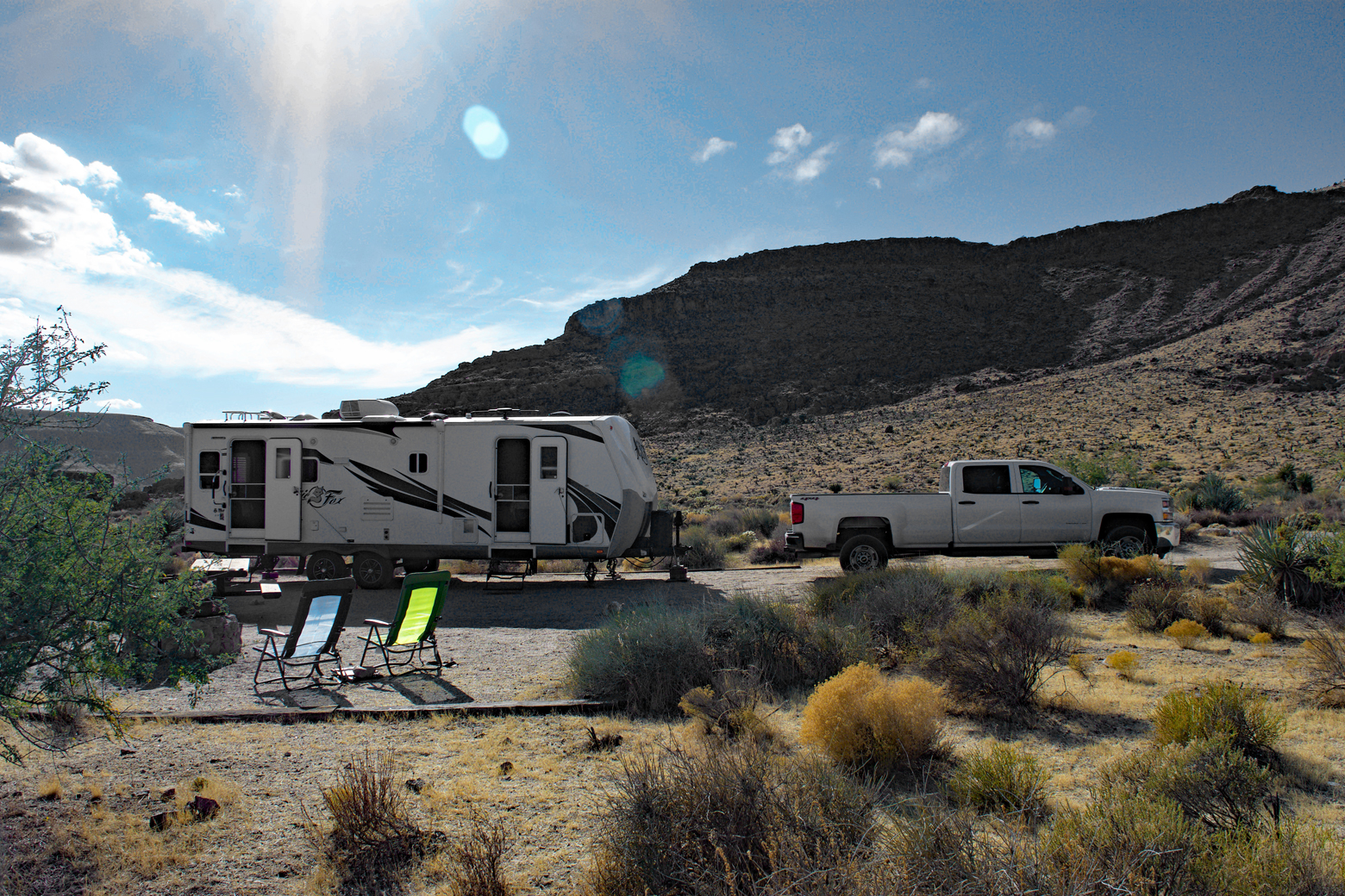 Our truck, trailer, and camping chairs in our campsite at Hole-in-the-Wall Campground
