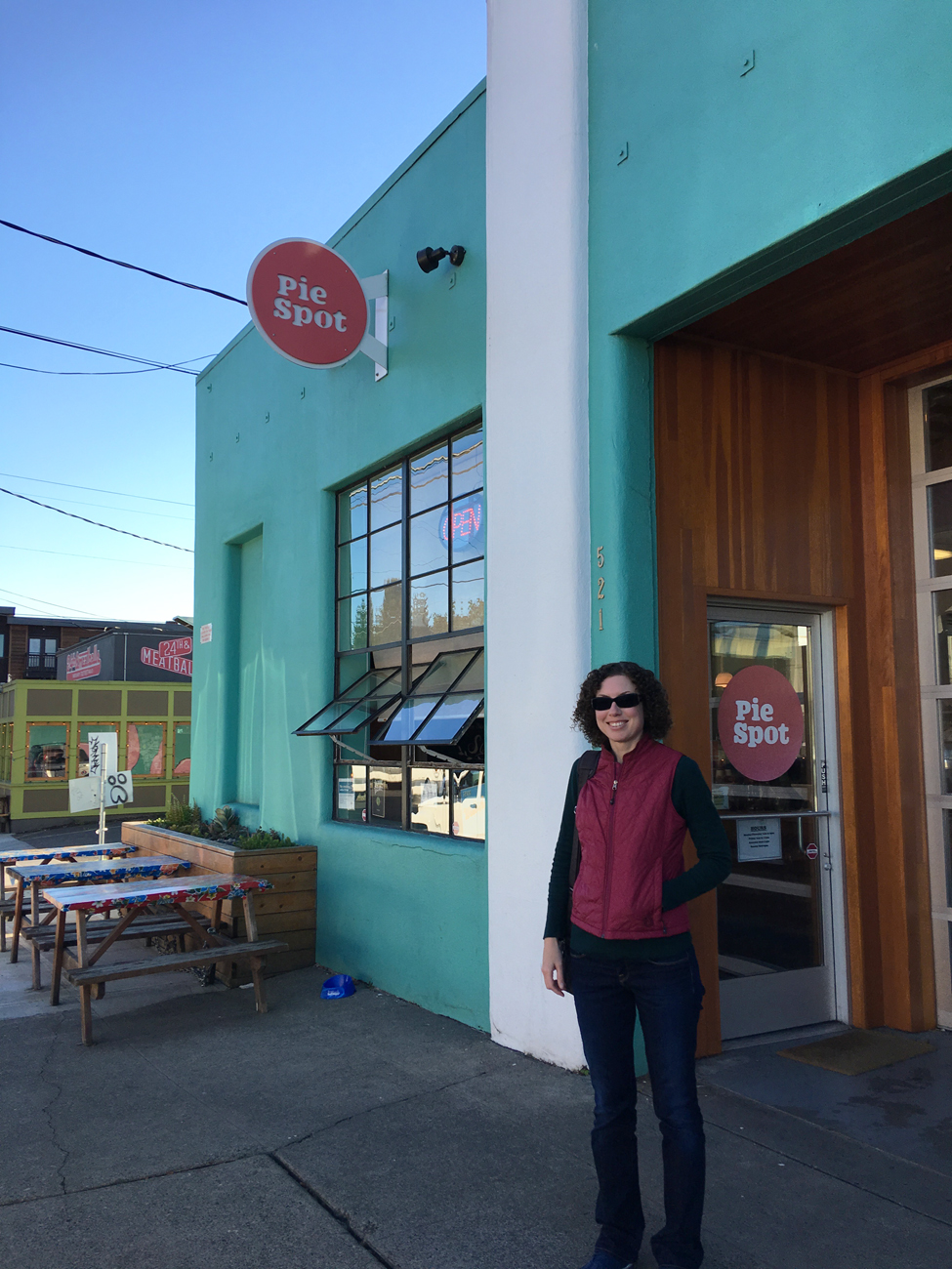 Christina standing in front of the Pie Spot in Portland