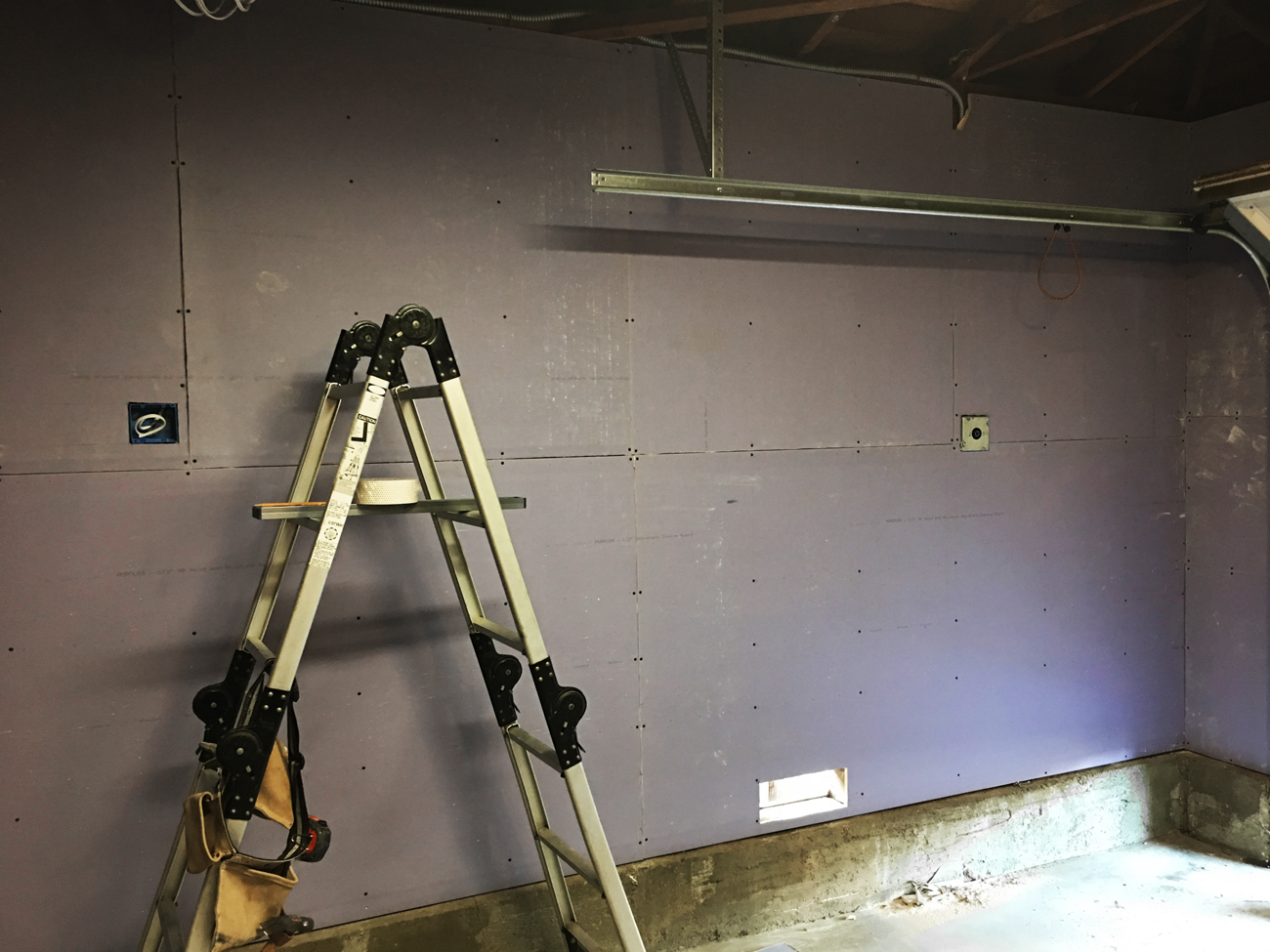 New Sheetrock on the garage wall at the Tiffanys