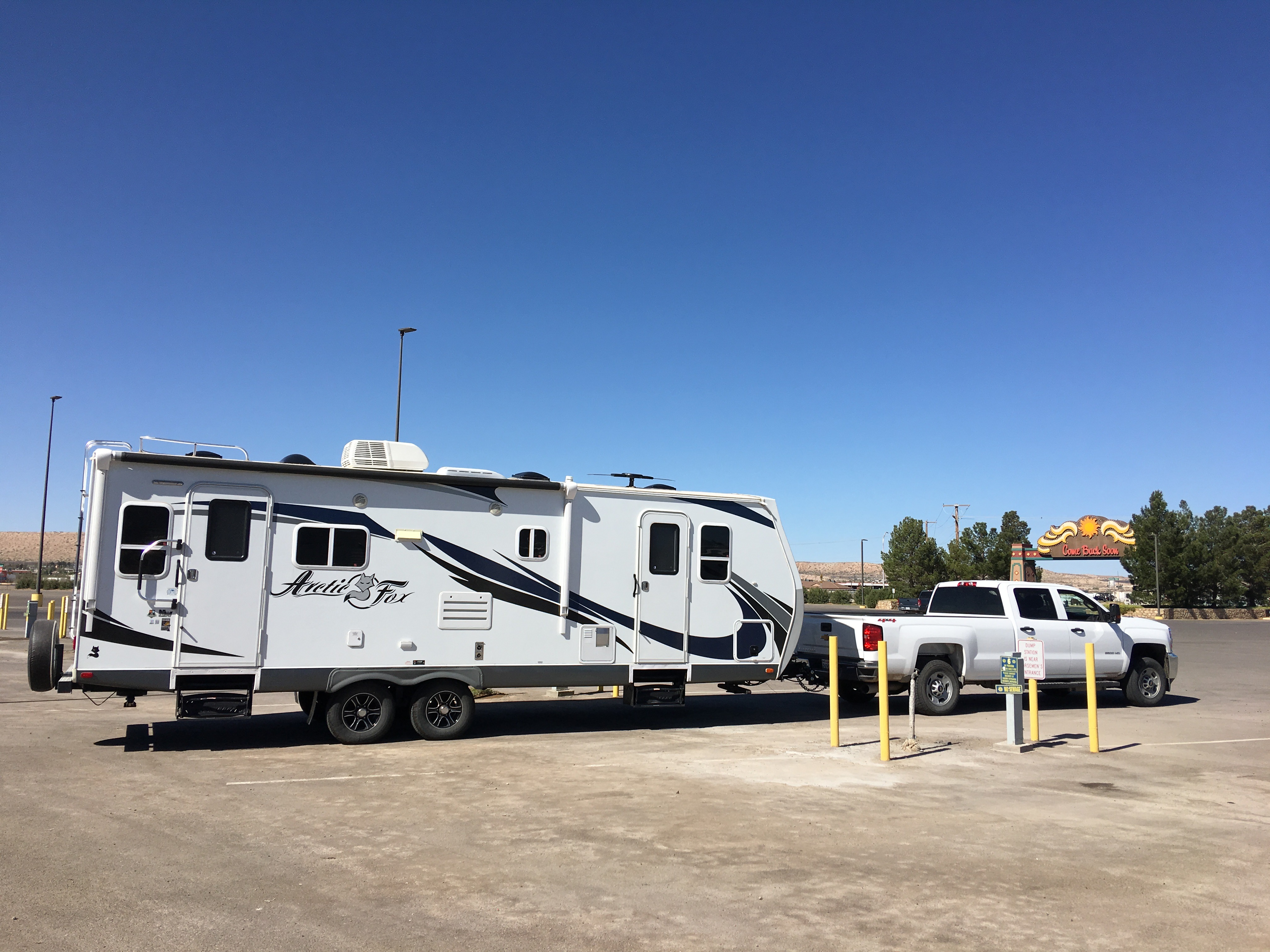Our truck and travel trailer parked in an RV site at the Sunland Park Racetrack and Casino