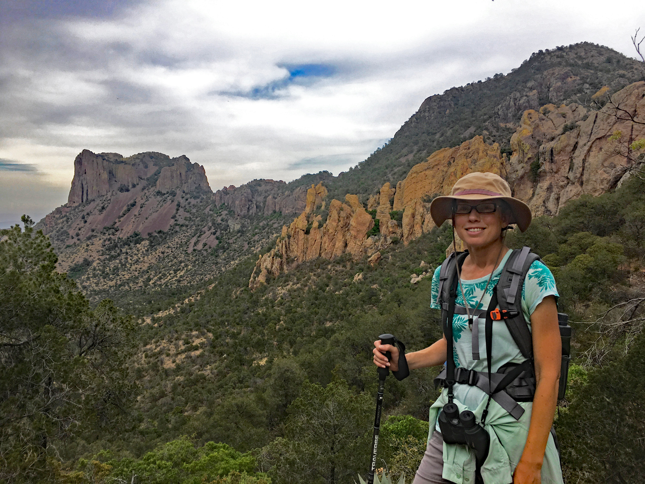 Christina and the view from the top of the Pinnacles Trail switchbacks in Big Bend National Park